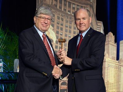 Jim Kessler receives the president's gavel from AREMA Past President Dwight W. Clark